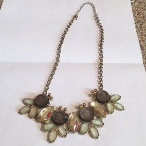 Flowery shape cut out statement necklace